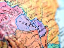 在地球地图的巴拉圭焦点宏观射击旅行博克、社会媒介、网站横幅和背景的 免版税库存照片