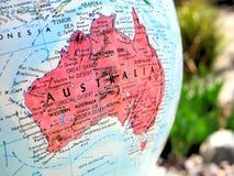 在地球地图的澳大利亚大陆焦点宏观射击旅行博克、社会媒介、网站横幅和背景的 库存图片