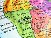 在地球地图的纳米比亚非洲焦点宏观射击旅行博克、社会媒介、网站横幅和背景的 免版税图库摄影