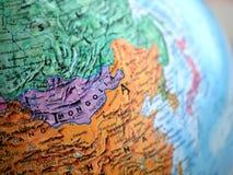 在地球地图的蒙古亚洲焦点宏观射击旅行博克、社会媒介、网站横幅和背景的 免版税库存图片