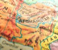 在地球地图的阿富汗焦点宏观射击旅行博克、社会媒介、网横幅和背景的 免版税图库摄影