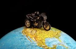 在地球的摩托车 免版税图库摄影