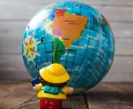 在地球的背景的玩具 库存图片