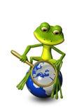 在地球的青蛙与放大镜 免版税库存照片
