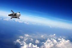 在地球附近的卫星。 库存图片