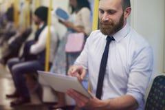 在地铁的商人 免版税库存照片