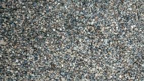 在地面、背景和纹理的石头形成与在上面的岩石表面 石渣在站点的夏天 库存图片