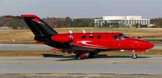 红色私有喷气机 图库摄影