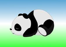 在地面上的睡觉熊猫 免版税库存图片