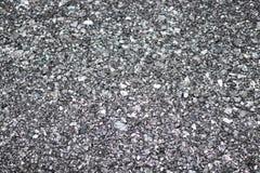 在地面上的石渣能用为背景 灰色红颜色 免版税库存照片