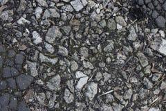 在地面和沥青的石头 库存照片