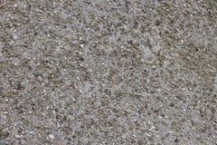 在地面和沥青的石头 免版税库存图片