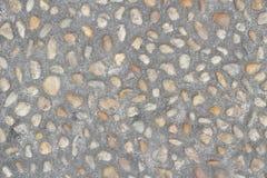在地面埋置的小小卵石 库存照片