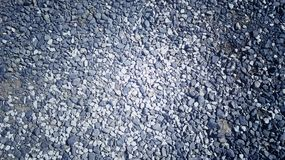 在地面的美丽的石头 库存图片