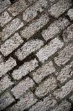 在地面背景的灰色砖纹理 库存图片