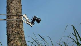 在场面之后 在室外地点的胶卷相机的记录片 免版税库存照片