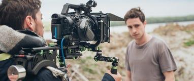 在场面之后 在照相机前面的演员 图库摄影