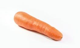 在块下的红萝卜在白色背景 免版税库存图片