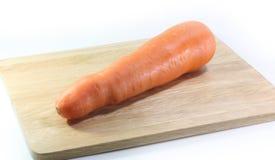 在块下的红萝卜在白色背景 库存照片