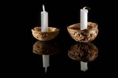 在坚果壳的蜡烛 图库摄影