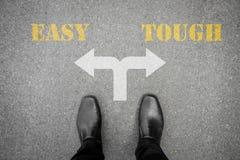 在坚韧的交叉路的决定-容易或 免版税图库摄影