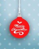 在垂悬的中看不中用的物品的圣诞快乐商标 免版税图库摄影