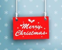在垂悬的标志的圣诞快乐商标 免版税库存图片