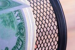 在垃圾篮子的财务资助现金欧洲钞票 库存照片