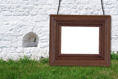 在垒的背景的木制框架 免版税库存照片