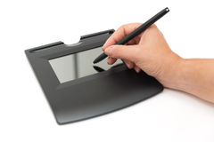 在垫的电子数字签名 免版税库存图片