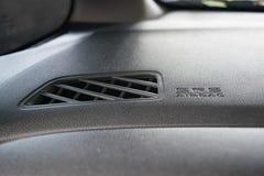 在城市汽车控制台的气袋象  免版税库存照片