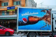 在城市道路的百事可乐流动卡车广告牌在春武里市,泰国 免版税图库摄影