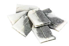 在堆安置的七个未使用的被标记的茶袋 免版税库存照片