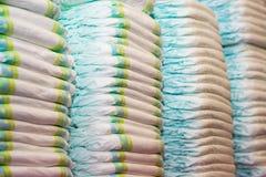 在堆积的儿童的尿布堆 免版税图库摄影