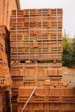 在堆积的穿孔的橙色砖块 免版税图库摄影