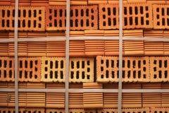在堆积的穿孔的橙色砖特写镜头块 库存图片