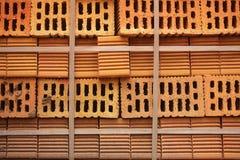 在堆积的穿孔的橙色砖特写镜头块 免版税库存图片