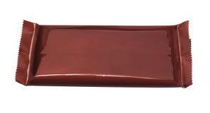 在塑料包装材料的巧克力块 免版税库存图片