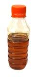 在塑料瓶的可食的芥末油 免版税库存图片