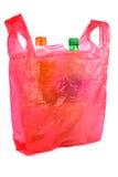 在塑料袋的瓶 库存图片