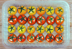 在塑胶容器的蕃茄 免版税图库摄影