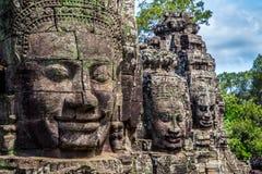 在塔的佛教面孔在Bayon寺庙,柬埔寨 免版税库存照片