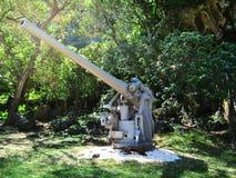 在塞班岛海岛上的更旧的日本枪  免版税库存图片