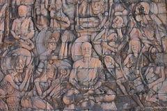 在墙壁上的低音安心在婆罗浮屠佛教寺庙 库存照片