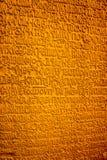 在墙壁上的古老文字 库存图片
