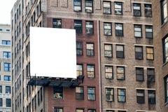 在墙壁上的大白色广告牌。 图库摄影