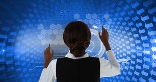 在墙壁上的妇女感人的蓝色接口 免版税库存图片