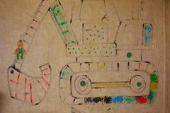 画在墙壁上的孩子 免版税库存图片