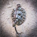 在墙壁上的恶魔石头 免版税图库摄影