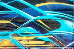 在墙壁上的抽象蓝色街道画艺术 免版税库存图片